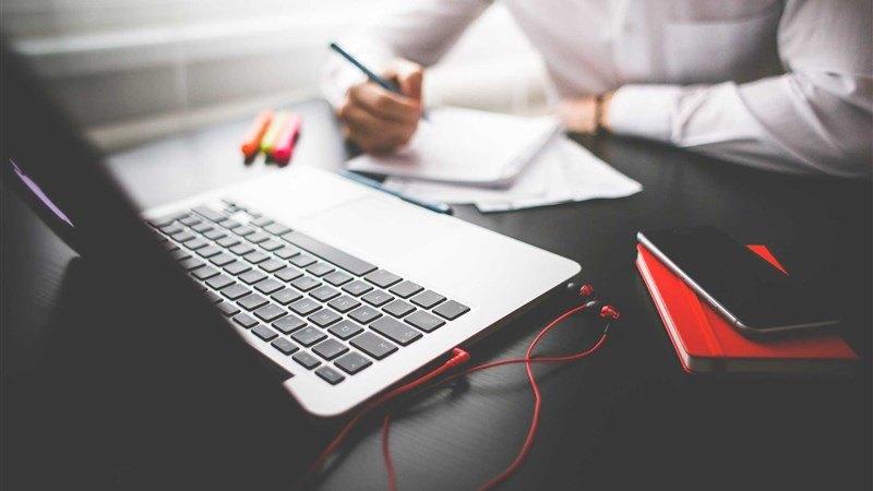 Entrepreneur Working on Macbook