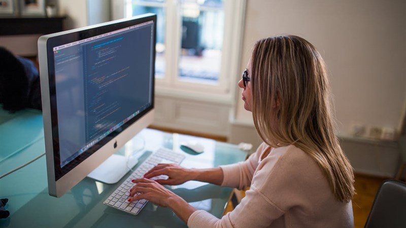 A Women Doing Computer Code