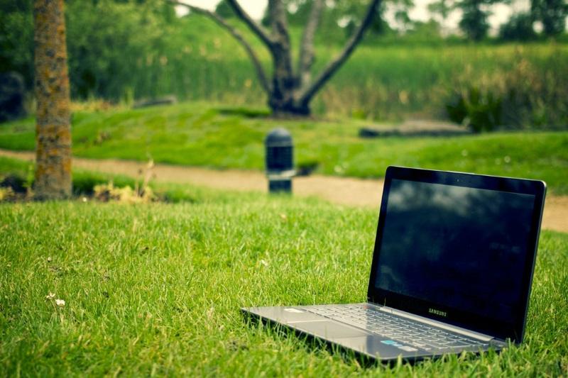 A Notebook Laptop on Grass