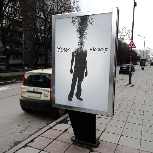 Poster displayed on street mockup
