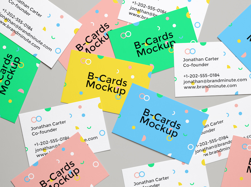 Business Cards scattered across mockup scene