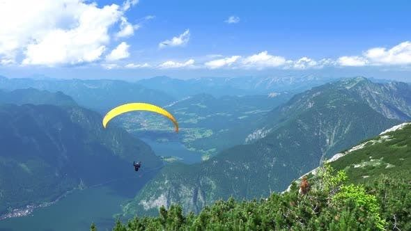 Paraglider over Mountains and Lakes